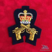 EE-076 - Crossed Pistol with Crown - Gold on Blue